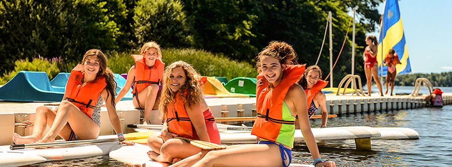girls sitting on paddle boards